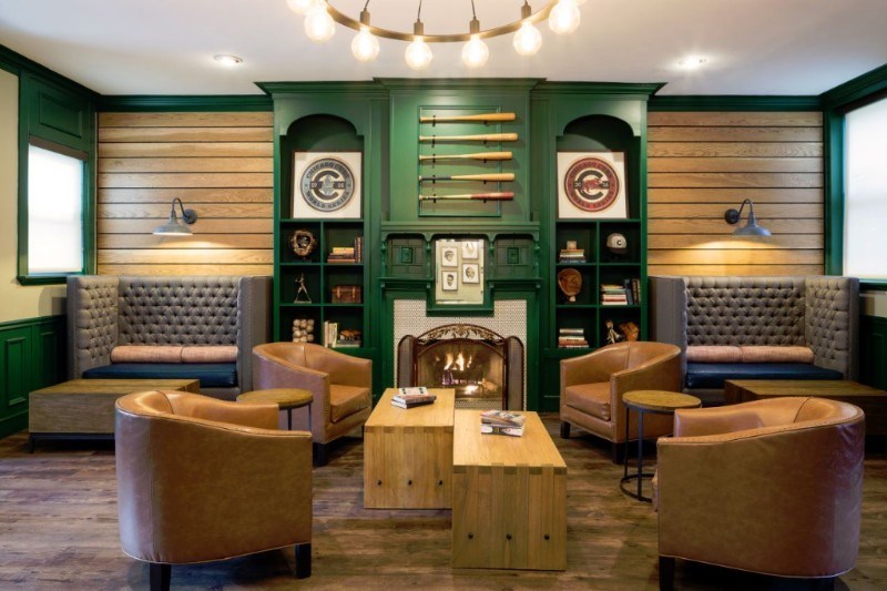 hotel with green walls and brown chairs