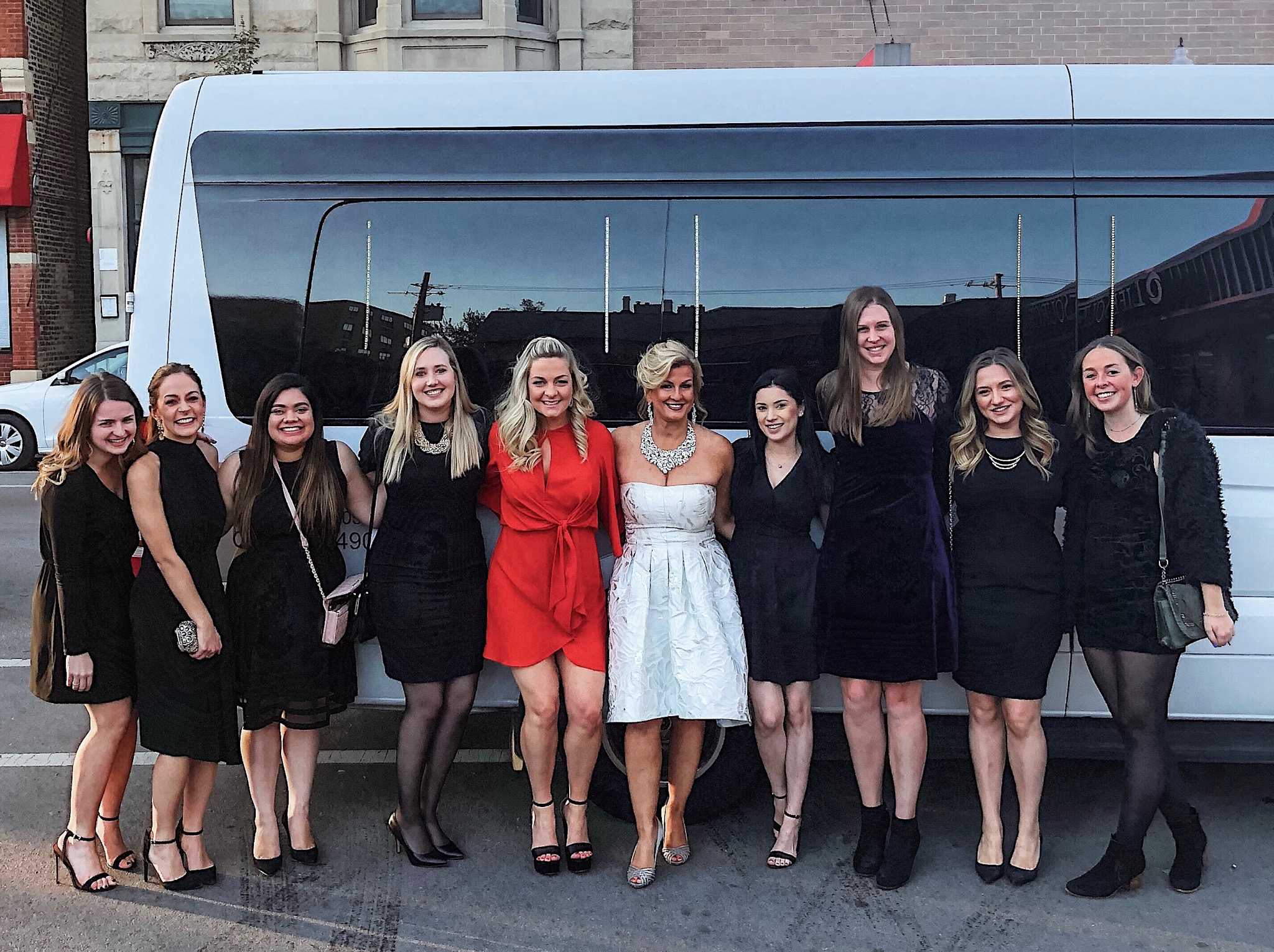 Women standing in front of a bus