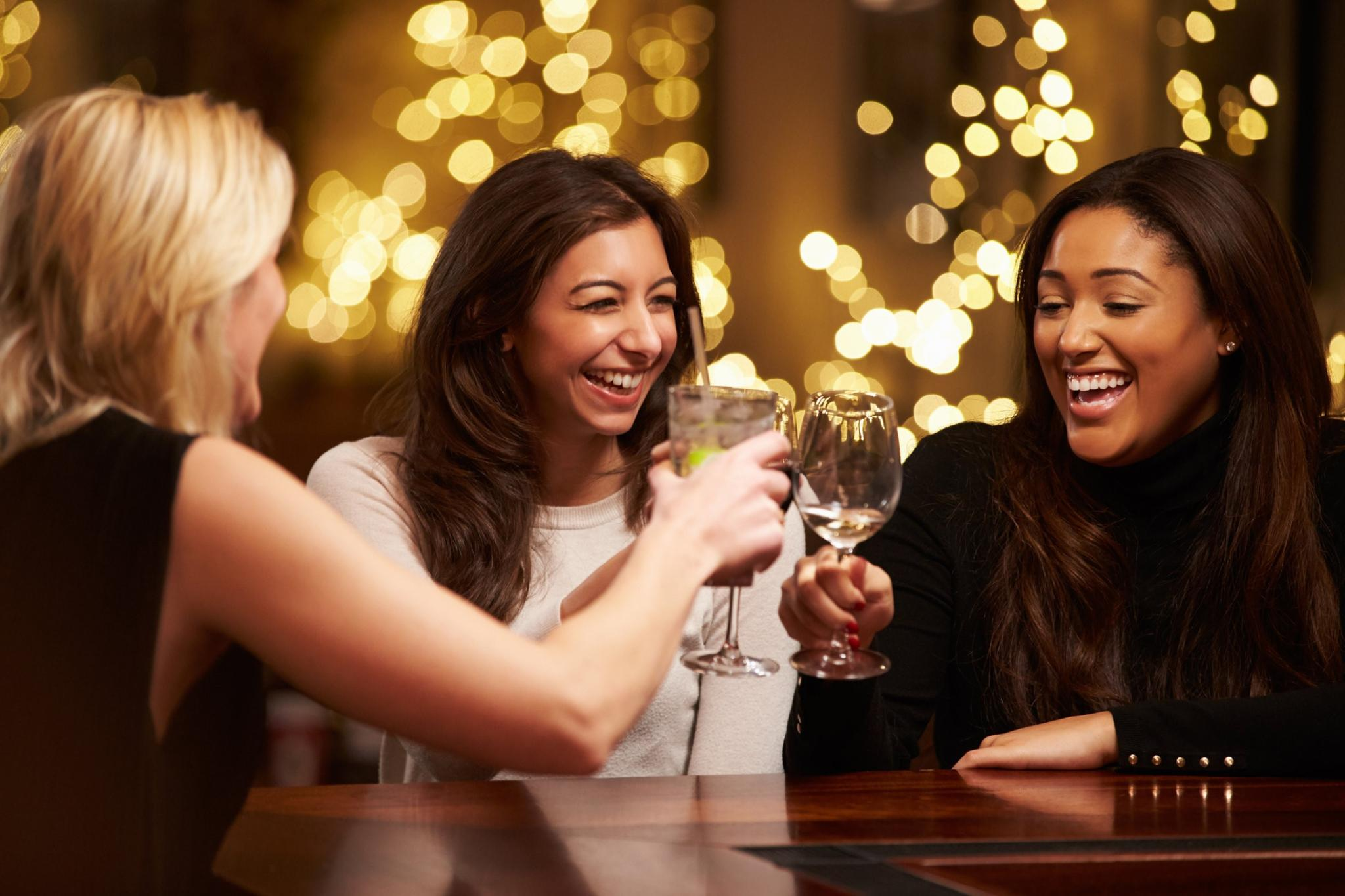 Women Toasting Wine Glasses