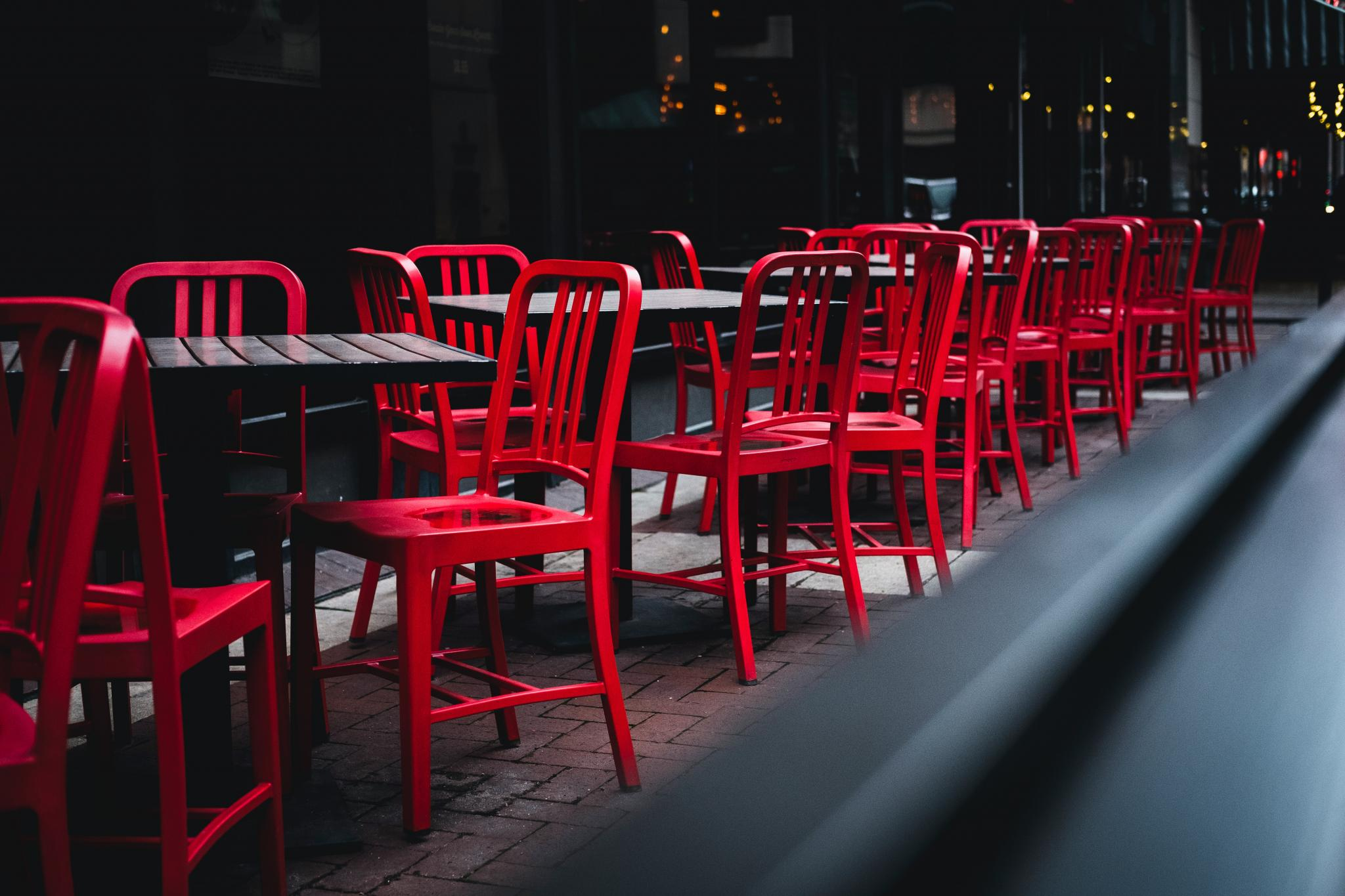 outdoor table with red chairs and carry-out